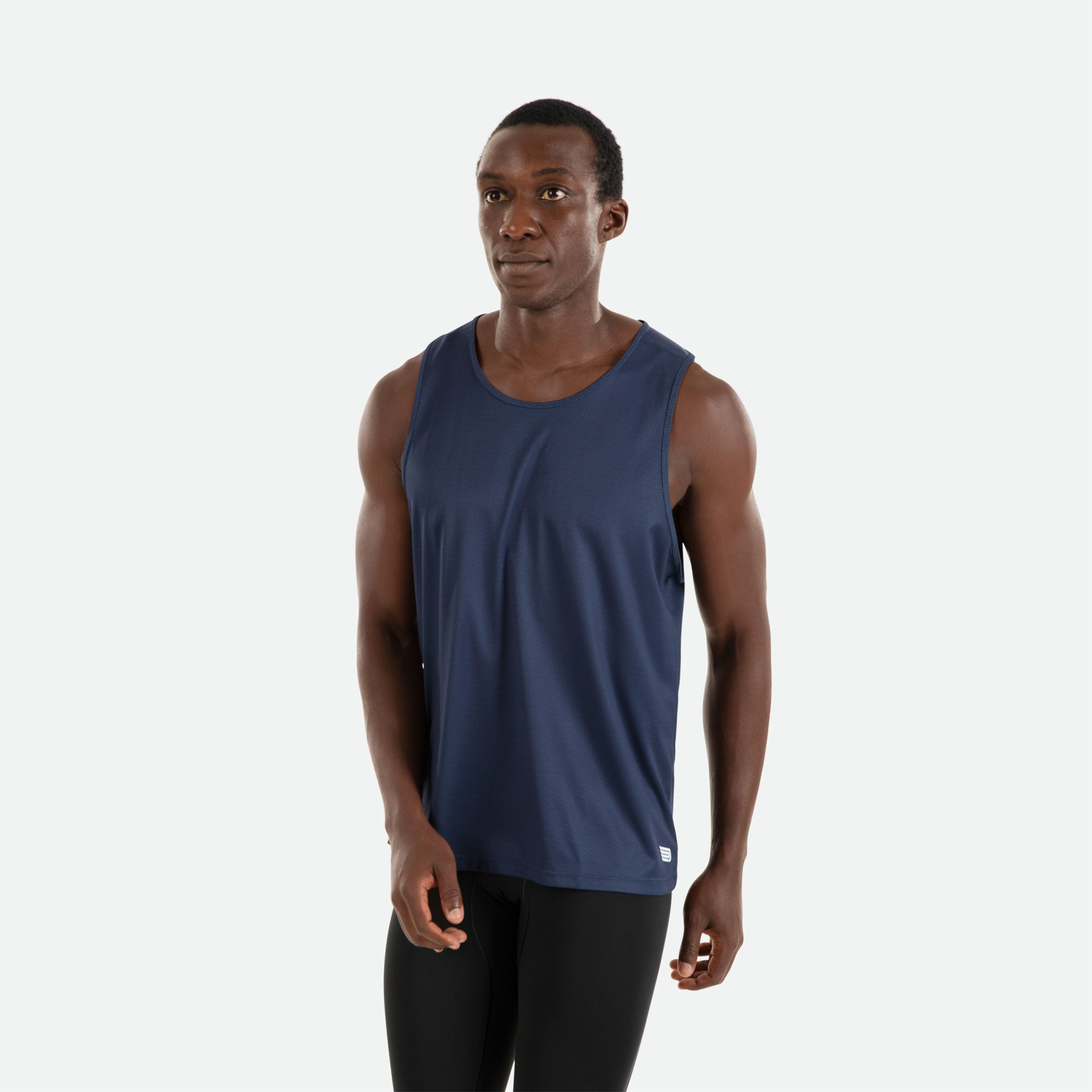 Our Pressio men's navy Hāpai singlet features EcoTECH MF fabric which has dual filament recycled polyester yarns from Unifi for superior moisture control to keep you dry.