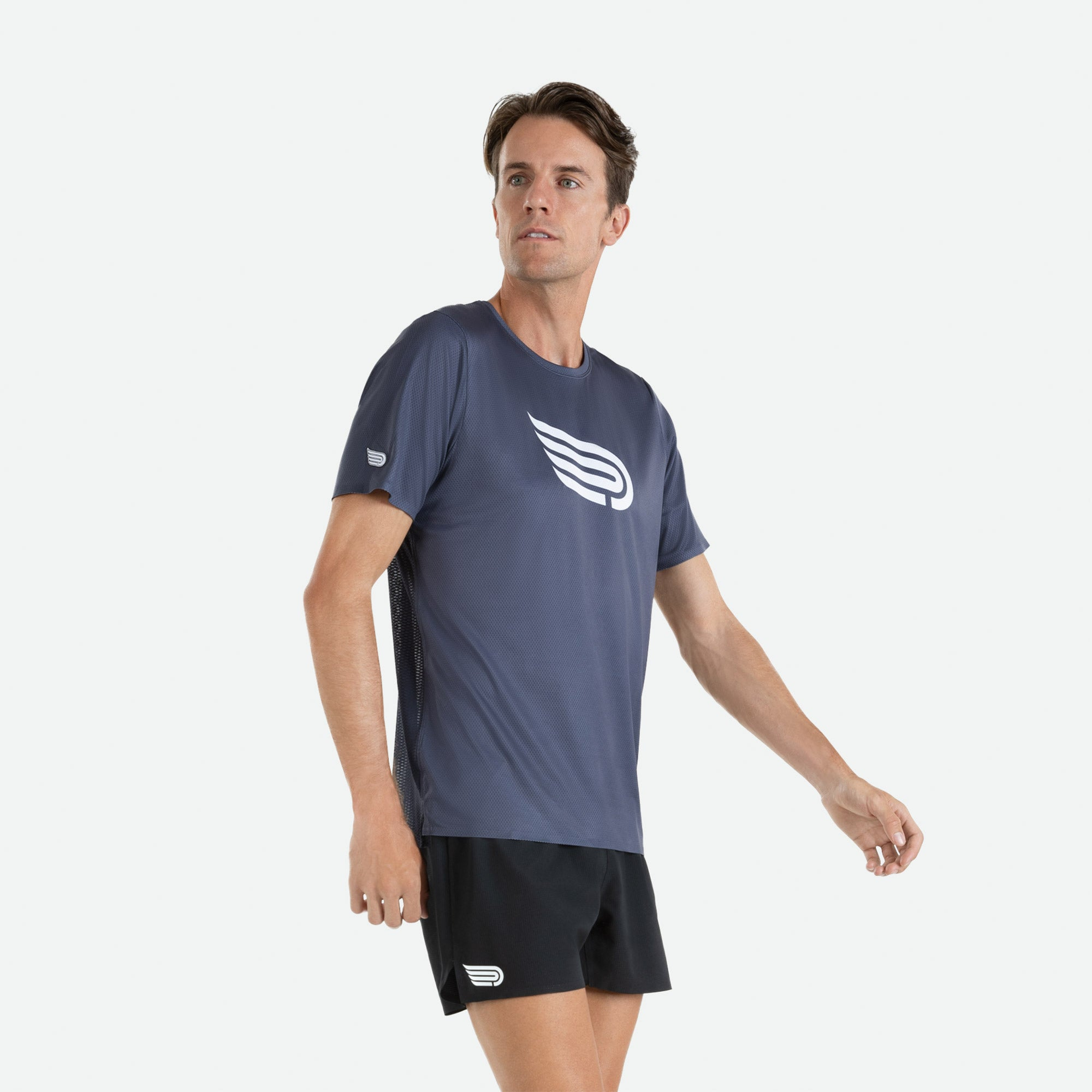 Short sleeve t-shirt men's Pressio Ārahi dark grey/white constructed of high filament mechanical knit fabric for unrestricted freedom of movement, enhanced comfort, and optimal hand feel.