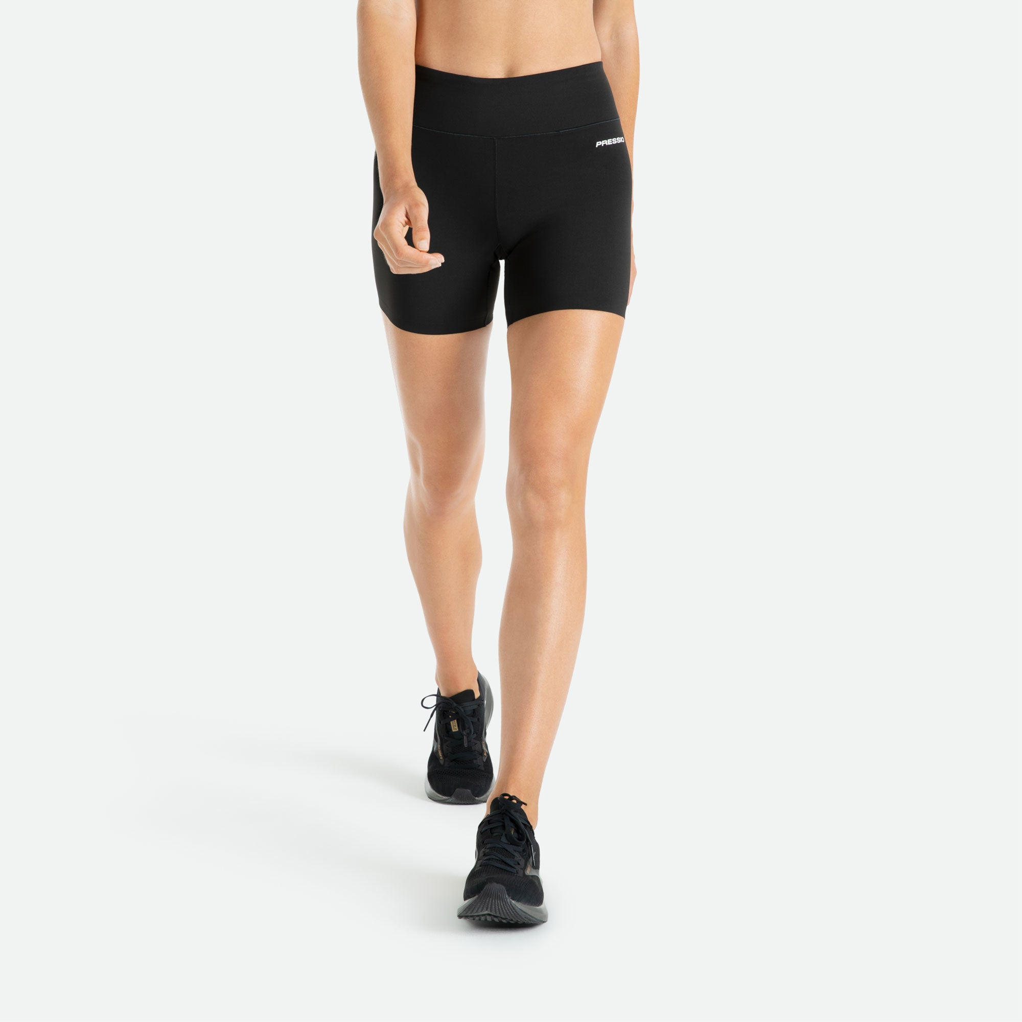 Pressio women's mid rise 3'' compression short made of high filament nylon yarns for comfort, moisture management, and durability.