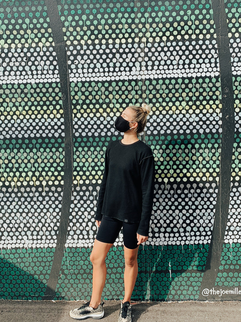 Athletic outfit with INFKNIT reversible long sleeve black side