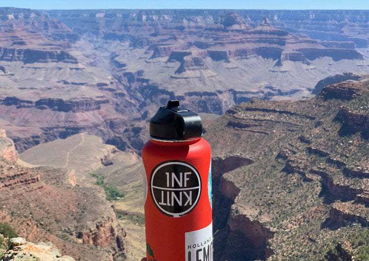 Red Reusable Water Bottle with INFKNIT Sticker