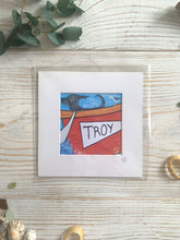Load image into Gallery viewer, Mini mounted print of a dog in a boat called Troy