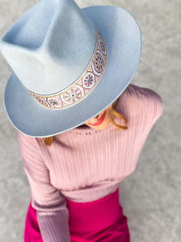 blue hat with pink outfit