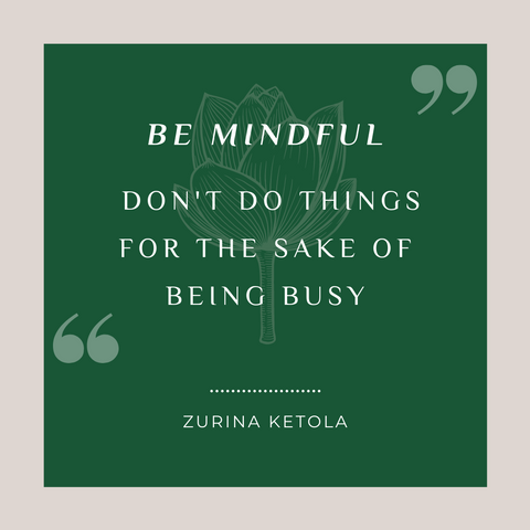 """""""Be Mindful. Don't do things for the sake of being busy."""" Quote graphic with green background and pale gray border with a stylized lotus flower image in the center."""