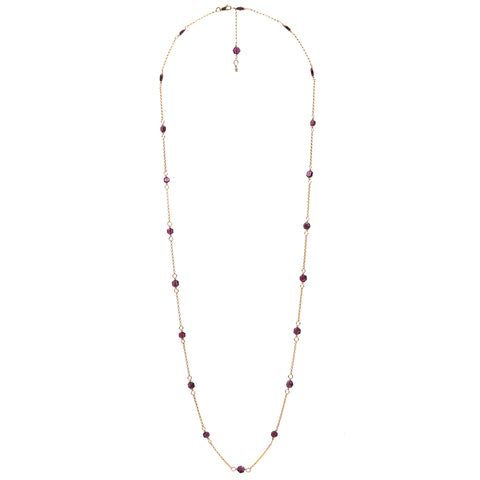 Zurina Ketola's Long Upcycled Garnet Necklace in 14K gold fill on white background.