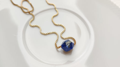 Close up of Zurina Ketola's Rose Cut Lapis Necklace in 14K gold fill.