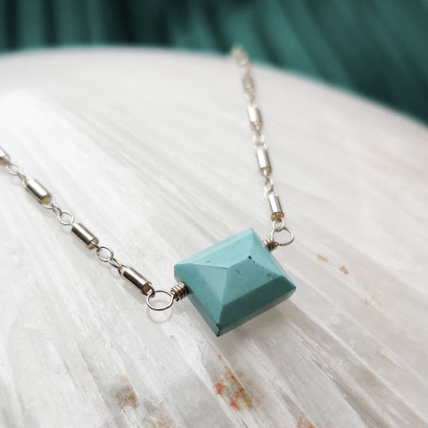 Close up side over view of Zurina Ketola's Turquoise Beaded Pyramid Necklace in sterling silver.