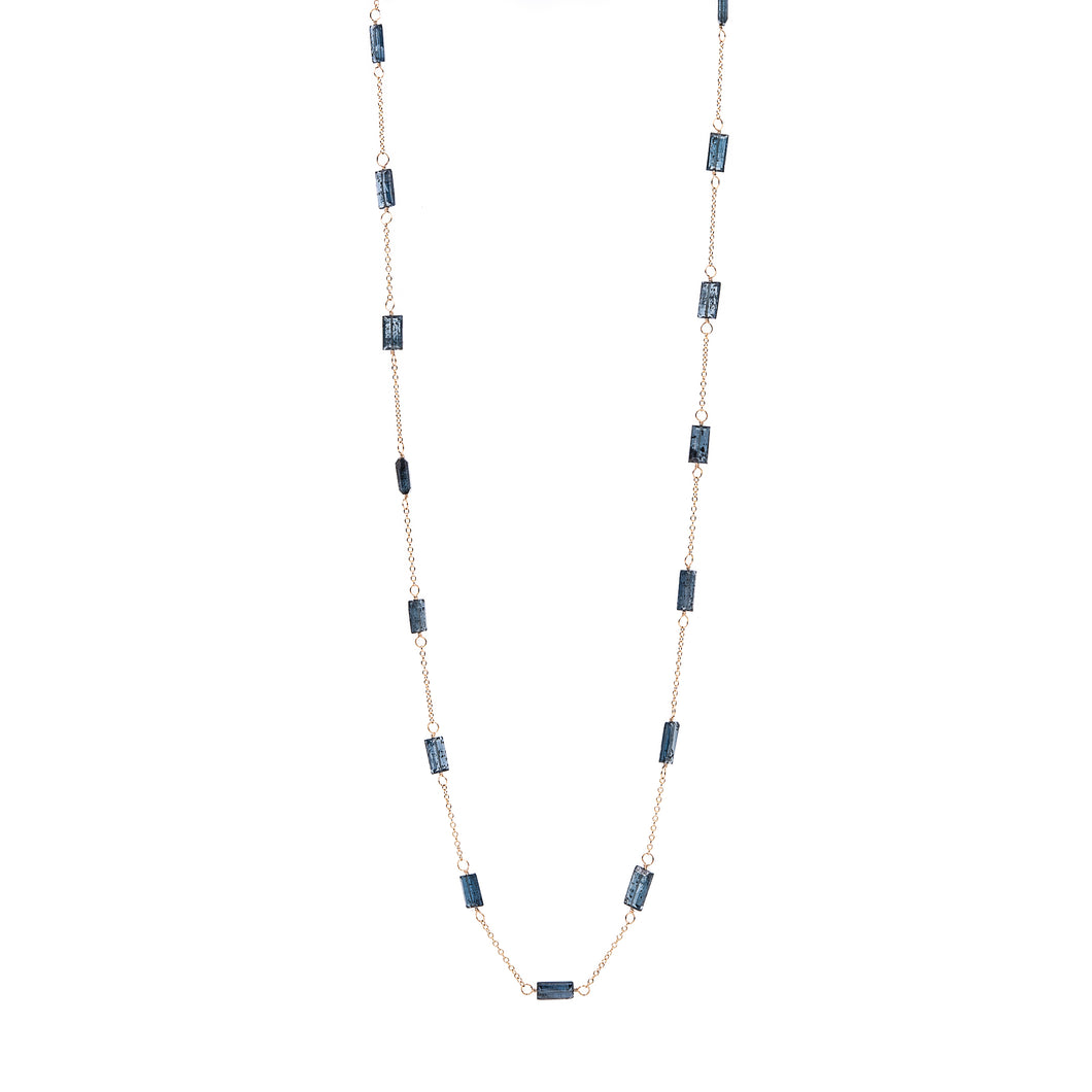 Zurina Ketola long moss aquamarine necklace in 14K gold fill shown long on white background.