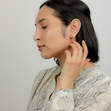 Load image into Gallery viewer, Model wearing disc chain loop earrings in 14K gold fill.