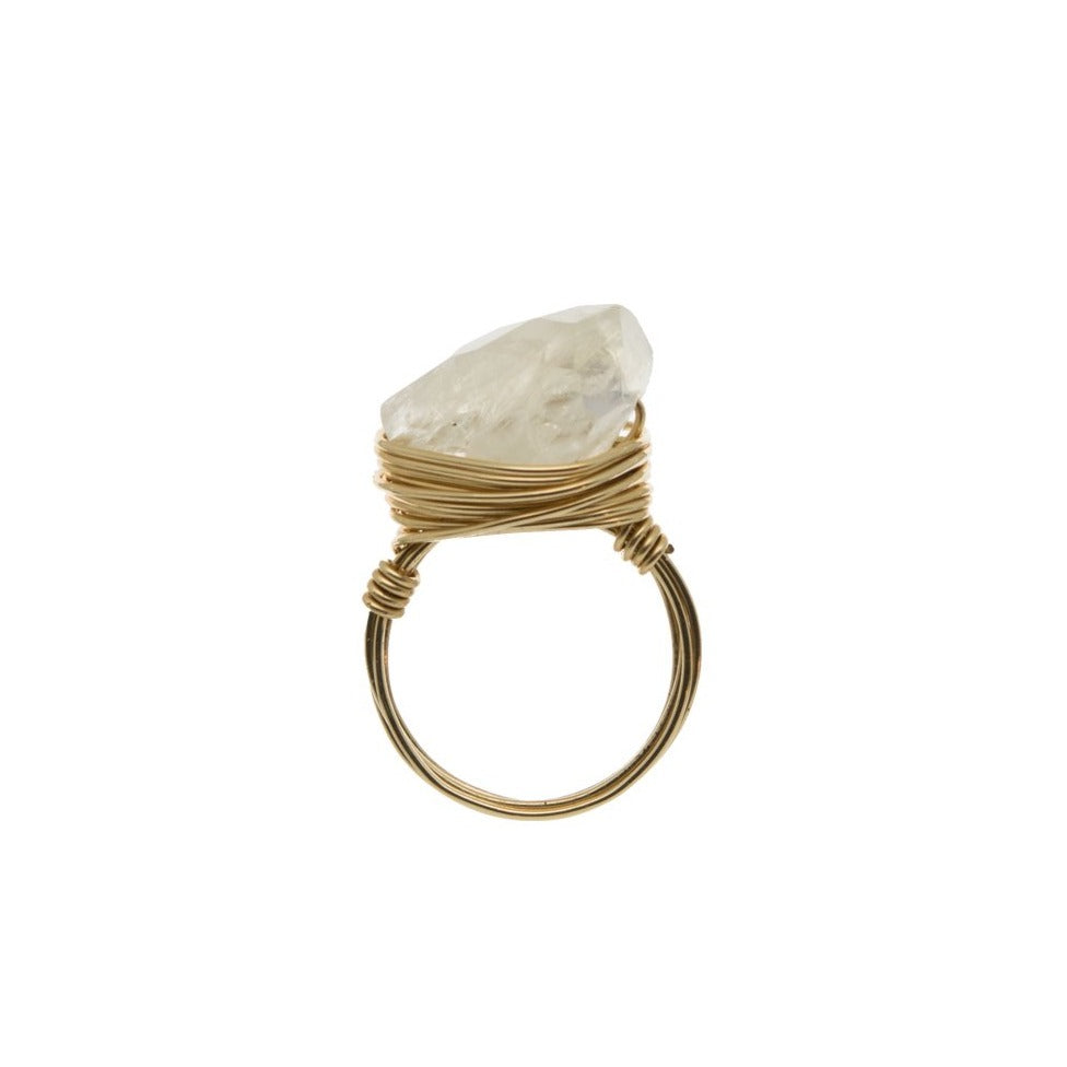 Zurina Ketola  rainbow moonstone ring in 14K gold fill on white background. Side iew.
