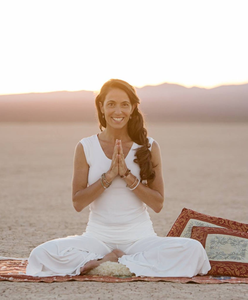 Angelic Yogini Kia Miller in off white.