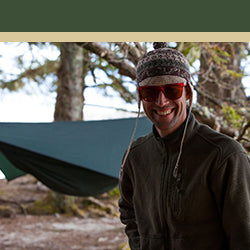 Image of a man standing with a hammock