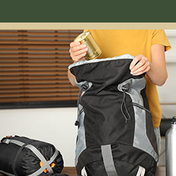 Image of a man packing a backpack