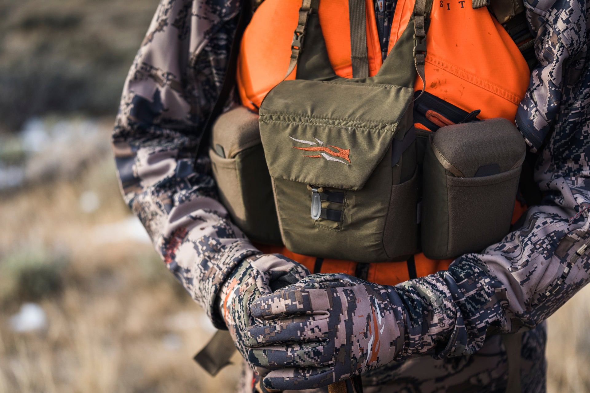 Sitka Gear - Man standing holding hands out front of him wearing the Jetstream Jacket
