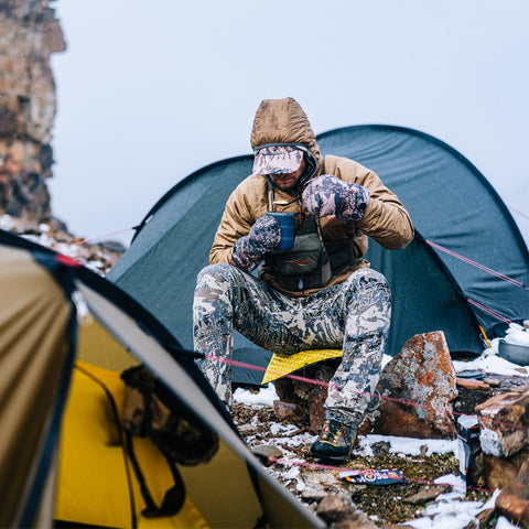 Kelvin Aerolite Jacket in Optifade Open Country - Man in Sitka gear sitting at a campsite