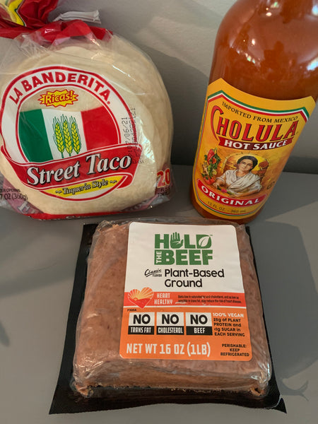 Tortillas, hot sauce and Hold the Beef plant-based ground protein