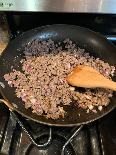 Pan of ground elk meat being cooked