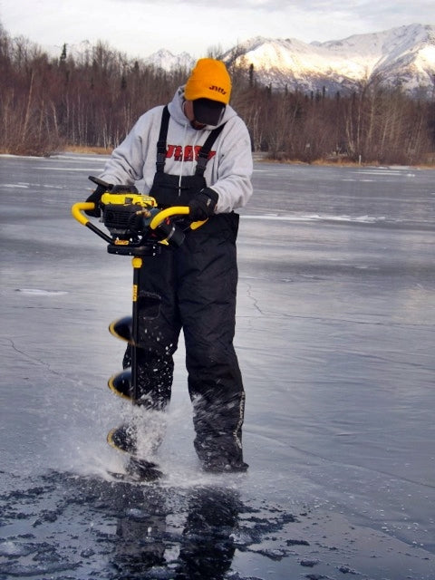 choosing the right ice auger drilling holes in ice
