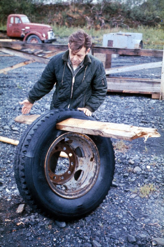 Tsunamis caused by the Good Friday Earthquake drove a 2x6 plank through this 10-ply truck tire at Whittier, Alaska.