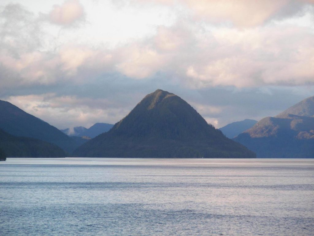 Cone Island, locally known as the China Hat. Narrow Klemtu Passage is on its left-hand side. - Milbanke Sound