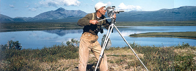 Richard Proenneke at Snipe Lake taking movies in 1975. He and his brother Raymond flew there in the J3 Cub. Photo courtesy of Raymond Proenneke Via Lake Clark NPS