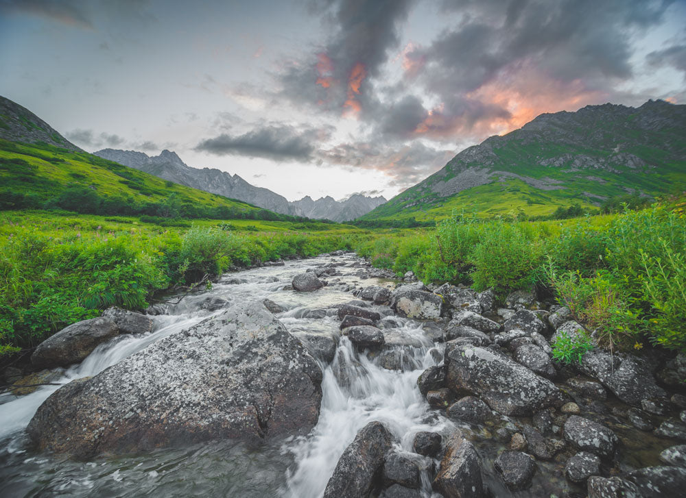 an image of archangel creek at sunset