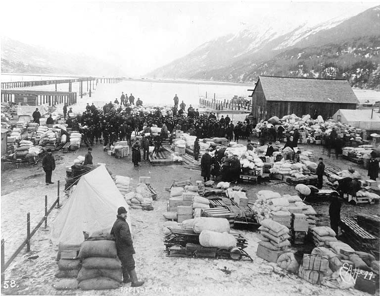 Piles of freight and supplies on the waterfront, Dyea, Alaska, 1898. Alaska Ghost Towns.