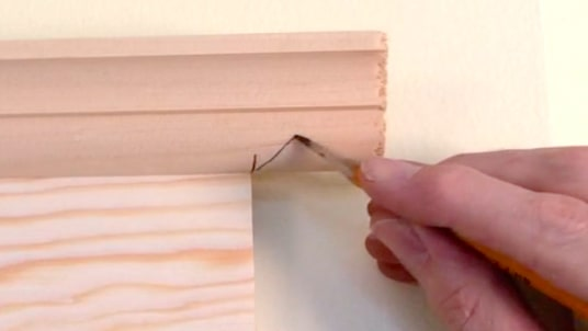 Measure trim length and mark to indicate the angle of the cut