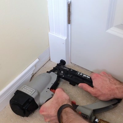 Install plinth block at the bottom of the door trim