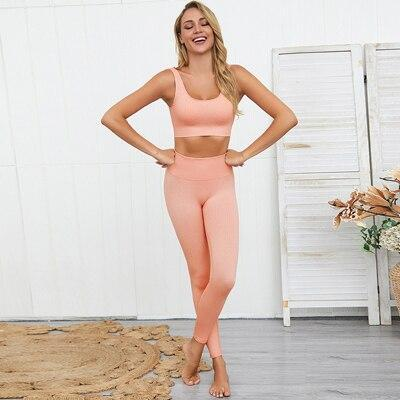 Woman gym yoga set sports bra and leggings in peach color