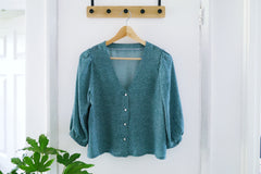 Self made blouse on hanger, made of Viscose Challis fabric.