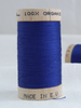 Wooden reel of organic cotton sewing thread in bright blue Ocean colour.