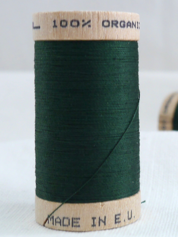 Wooden reel of organic cotton thread in Forest green