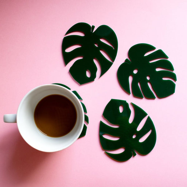 Cheese plant leaf coasters with cup of tea