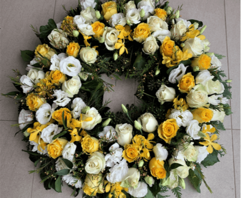 Large white and yellow flowers funeral wreath.