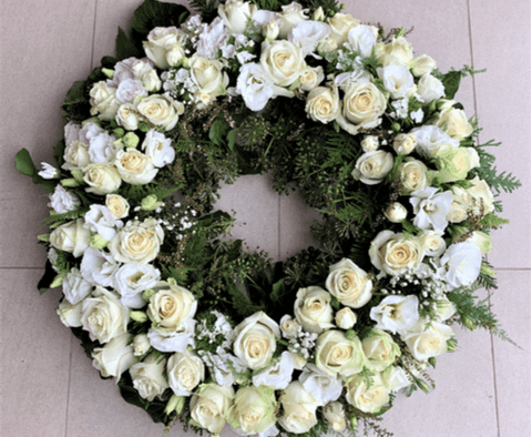 Funeral flower wreath with white flowers
