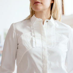 Find an authentic preowned Givenchy White Cotton Shirt With Frills, size 44 (Italian) at BunnyJack, where a portion of every sale goes to charity.
