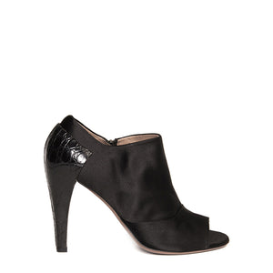 Find an authentic preowned Azzedine Alaia Black Peep Toe Ankle Boots size 40.5 (Italian) at BunnyJack, where a portion of every sale goes to charity.