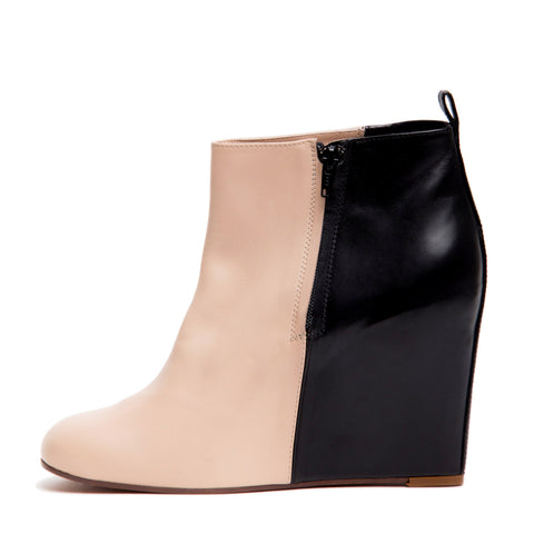 Find an authentic preowned Celine Black & Natural Hidden Wedge Ankle Boots, size 41 (Italian) at BunnyJack, where a portion of every sale goes to charity.