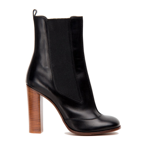 Find an authentic preowned Celine Black Chelsea Mid-Calf Boot, size 41 (Italian) at BunnyJack, where a portion of every sale goes to charity.
