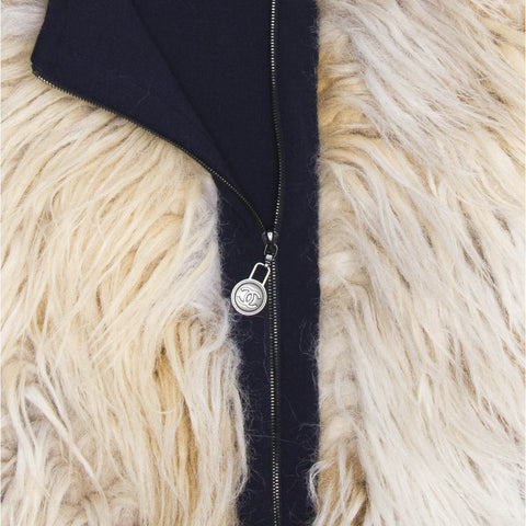 Find an authentic preowned Chanel Cream & Black Wool Fur Vest, size 34 (French) at BunnyJack, where every sale triggers a charity donation.