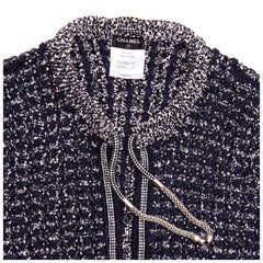 Find an authentic preowned Chanel Navy & Silver Knit Jacket, size 42 (French) at BunnyJack, where every sale triggers a charity donation.