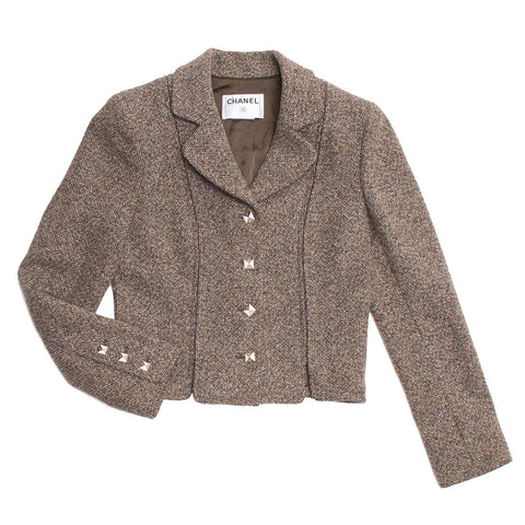 Find an authentic preowned Chanel Brown Tweed Skirt Suit, size 44 (French) at BunnyJack, where every sale triggers a charity donation.