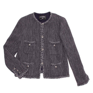 Find an authentic preowned Chanel universal navy and grey herringbone jacket size 46 (French) at BunnyJack, where a portion of each sale goes to charity.