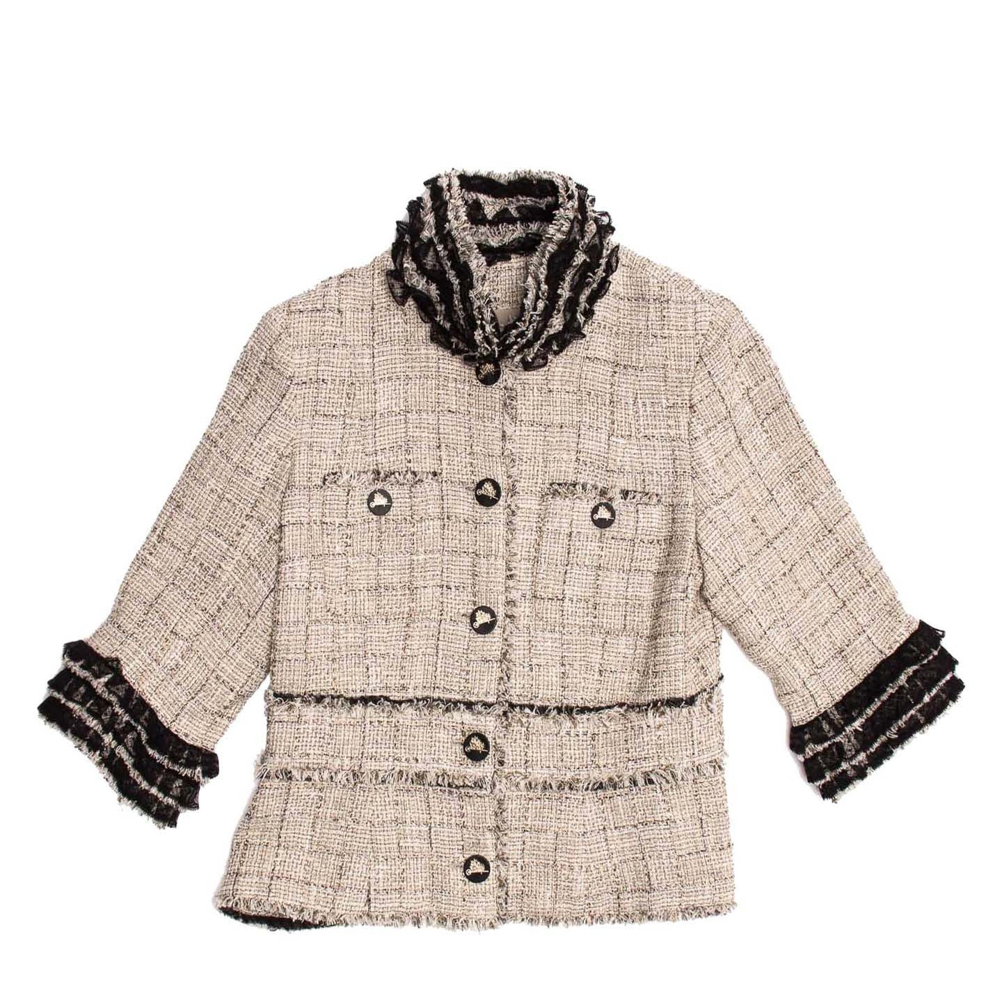 Find an authentic preowned Chanel Beige Cotton & Lace Jacket size 44 (French) at BunnyJack, where a portion of every sale goes to charity.
