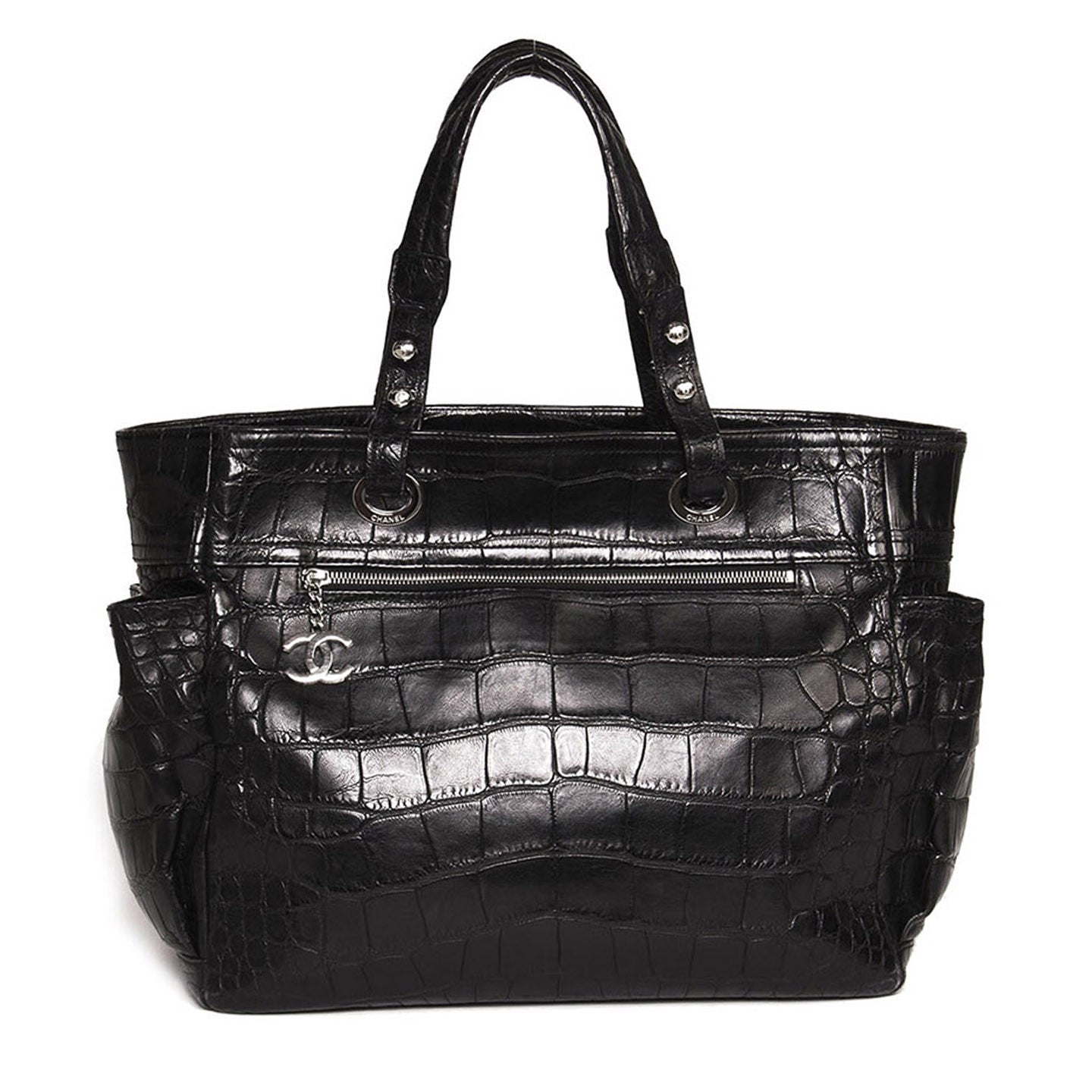 Find this chic vintage Chanel black Crocodile shoulder bag at BunnyJack, where up to 50% of each sale price is donated to a deserving charity.