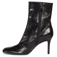 Find an authentic pair of preowned Chanel Black Round Toe Boots, size 41 (Italian) at BunnyJack, where every sale triggers a charity donation.