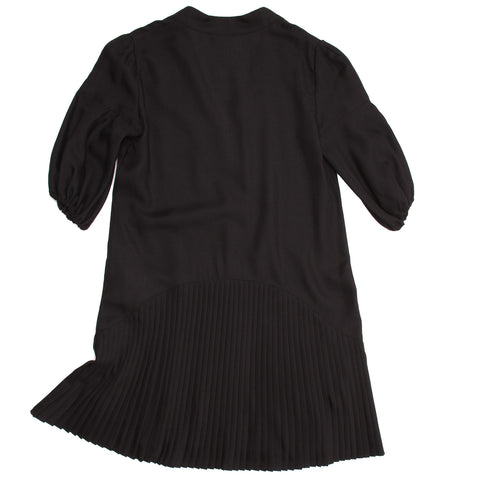 Find an authentic preowned Givenchy Black Wool Pleated Dress, size 42 (French) at BunnyJack, where a portion of every sale goes to charity.