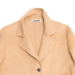 Find an authentic preowned Jil Sander Camel Cashmere Coat, size 38 (French) at BunnyJack, where a portion of every sale goes to charity.