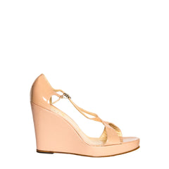 Find an authentic preowned Christian Louboutin Nude Patent Leather Wedges, size 41 (Italian) at BunnyJack.